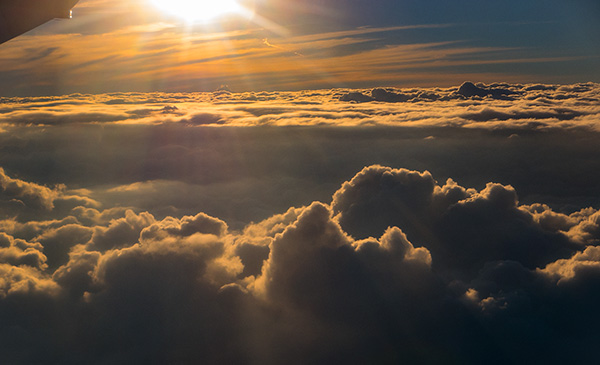 sun rays over clouds at 33,000 feet